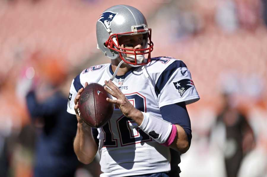 New England Patriots quarterback Tom Brady warms up before an NFL football game against the Cleveland Browns Sunday, Oct. 9, 2016, in Cleveland.