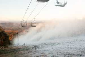 In this photo provided by Killington Ski Resort, snowmaking is underway on the resort'sNorth Ridge trails.