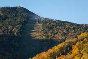 In this photo provided by Killington Ski Resort, snowmaking is underway on the resort's North Ridge trails.