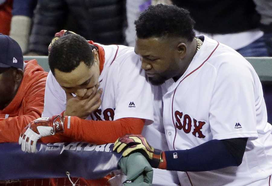 Boston Red Sox's David Ortiz, right, hugs Mookie Betts in the dugout during the eighth inning in Game 3 of baseball's American League Division Series against the Cleveland Indians, Monday, Oct. 10, 2016, in Boston. The Indians won 4-3 to sweep the Red Sox in the series.