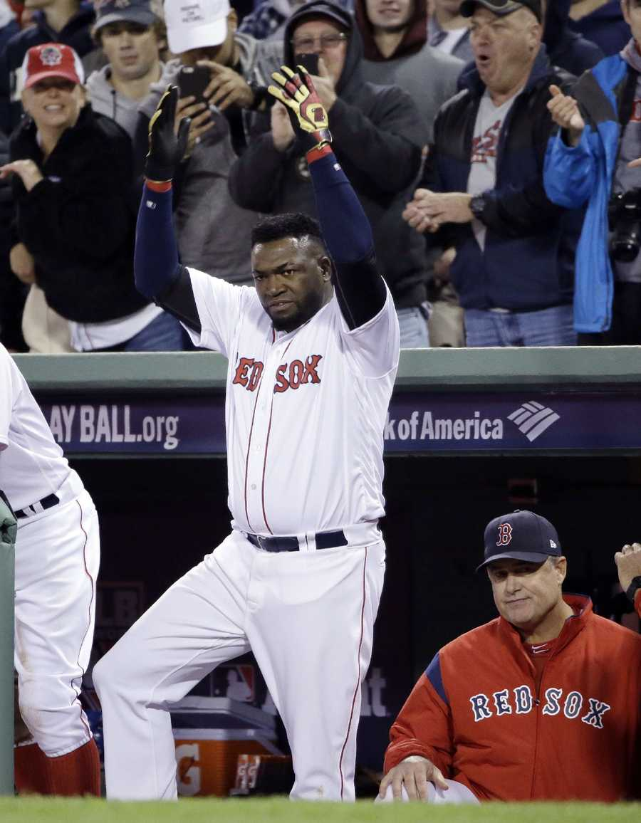 Boston Red Sox designated hitter David Ortiz encourages the crowd beside manager John Farrell in the dugout during the eighth inning in Game 3 of baseball's American League Division Series against the Cleveland Indians, Monday, Oct. 10, 2016, in Boston.