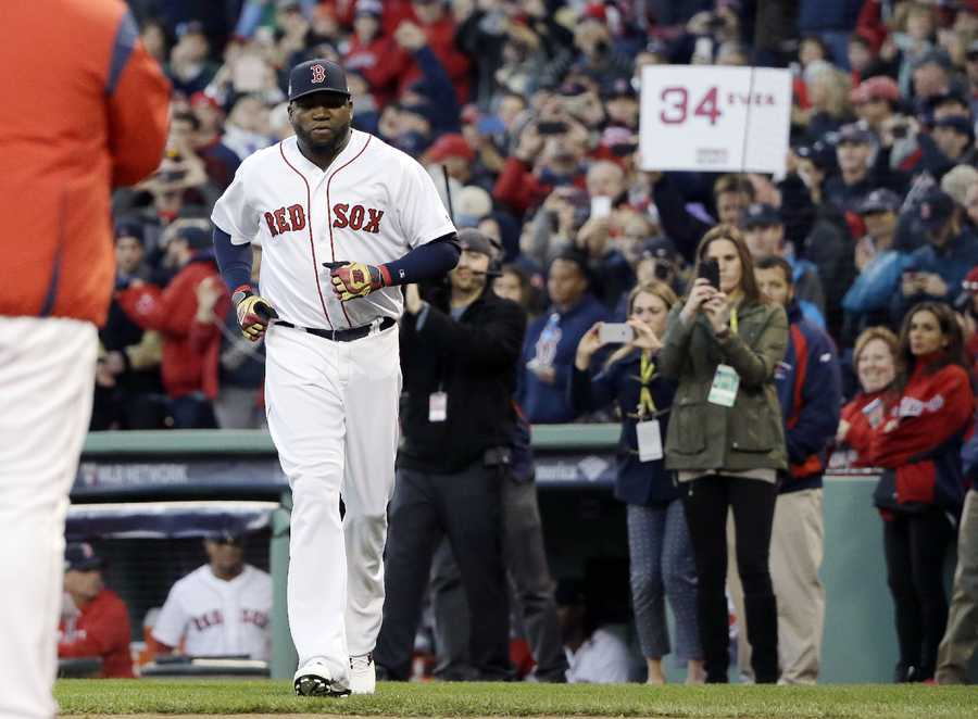 Boston Red Sox designated hitter David Ortiz runs onto the field during introductions before Game 3 of baseball's American League Division Series Cleveland Indians, Monday, Oct. 10, 2016, in Boston.