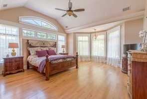The Master Bedroom features a spa- inspired bath and walk in closets.