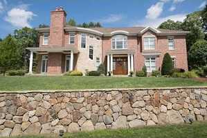 GRACIOUS, CUSTOM RESIDENCE sited on a private lot, in a very desirable location.