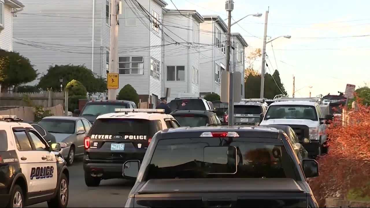 At least two men were removed from a home in Revere after police surrounded the home for several hours.