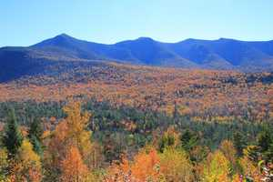 If you can't visit the area in person, swipe through these photos showing peak color across the White Mountains and Mount Washington Valley.