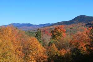 The Sugar Hill Scenic Vista offers breathtaking views of the White Mountains and the rainbow of colors.
