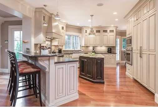 The spacious chef's kitchen features top of the line stainless steel appliances, leathered granite countertops and a separate eating area.