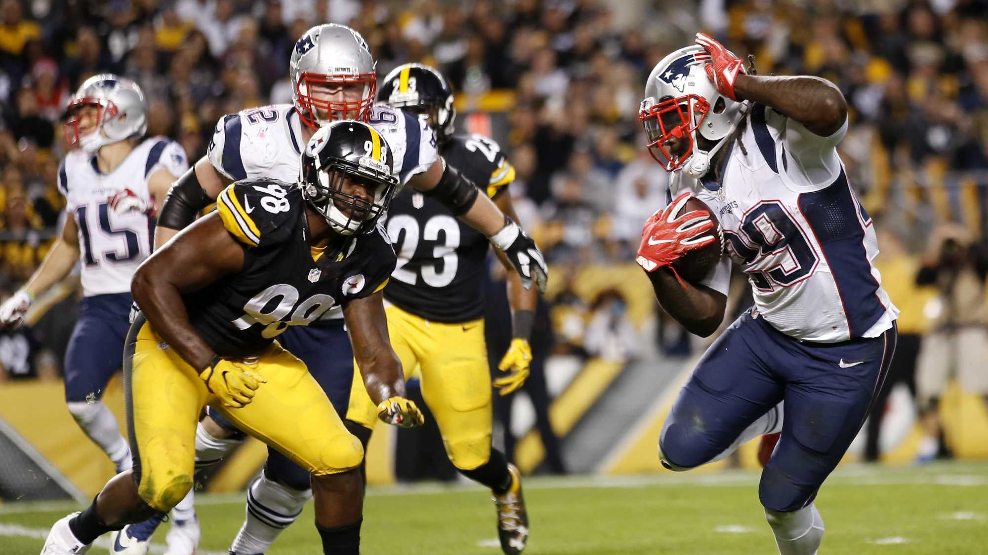 New England Patriots running back LeGarrette Blount (29) gets into the end zone for a touchdown past Pittsburgh Steelers inside linebacker Vince Williams (98) during the second half of an NFL football game in Pittsburgh, Sunday, Oct. 23, 2016.