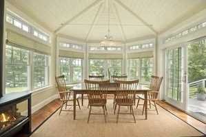 The high vaulted dining room leads via French doors to the vaulted porch, with gas fire pit and panoramic views.
