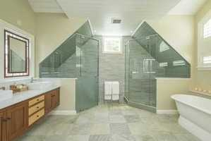 Spacious master suite includes luxurious bath and a reading loft.