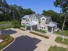 Estate includes a detached Carriage House with HVAC, workshop, attached shed and a separate entrance 2nd story artist's studio/loft