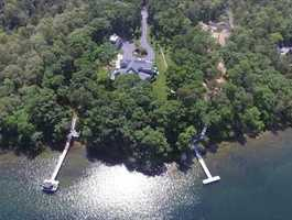 Waterfront: Spectacular newly built private estate (3.824 acres) with 235' of frontage with dock on Great Herring Pond.