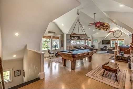 An enormous games room with hot tub and pool table.