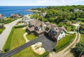This gracious and beautifully appointed shingle style home boasts panoramic ocean views without the worry or cost of direct waterfront.