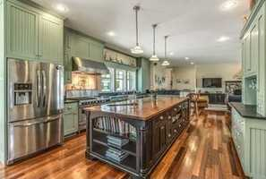 A gourmet chef's kitchen with stainless steel appliances.