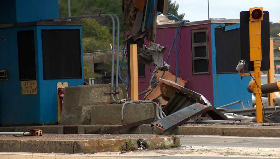 Construction crews are working through the night to demolish toll plazas on Massachusetts Turnpike.