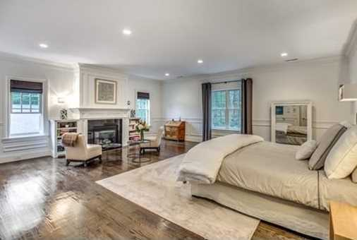 Exquisite built-ins, dark stained oak flooring and wainscoting throughout hallways and the Master Suite.