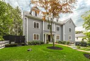 Spectacular one-year young 6,074sf Colonial with top-of-line designer finishes and amenities.