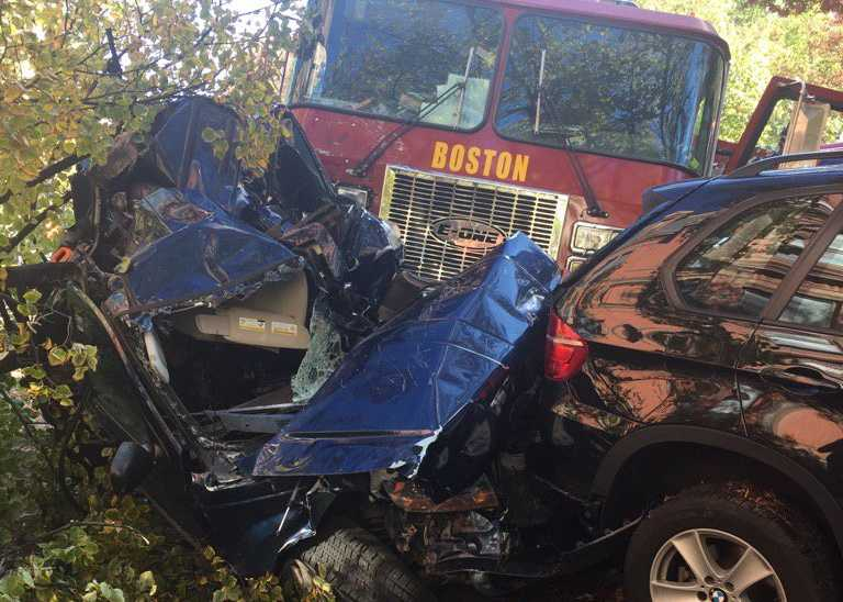 Five people were injured Monday in a crash involving a fire truck, an SUV and several other vehicles in Boston's Back Bay.