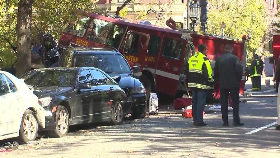 The line of cars were all parked, and the sidewalk was empty, according to the fire department.