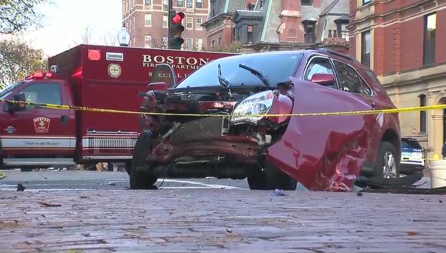 The crash, which involved Engine No. 7 and this red SUV, happened at about 11:30 a.m. Monday at the intersection of Commonwealth Avenue and Dartmouth Street, according to Boston Fire.