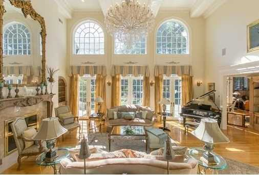 The residence is filled with grandeur & meticulous details with soaring ceilings & windows, extensive marble, hardwood floors, extraordinary moldings, paneling, & fine finish work.