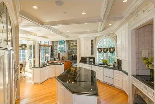 Entertain in the gourmet 2-cook kitchen, European, banquet-sized dining rm, dramatic family rm with cypress, chestnut & Vermont stone details, breathtaking 2 story living rm, billiard room & home theater with a pub & wine cellar.