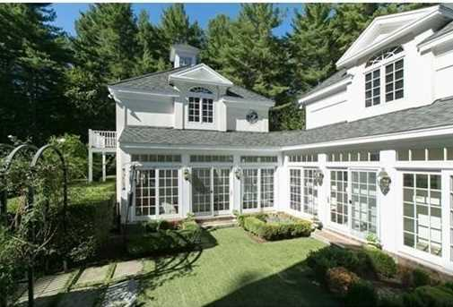 Many rooms step out to the grounds thru French doors & a glassed loggia leads to a fireplaced 1 BR carriage house & attached, 6 bay garage.