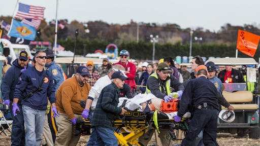 Paramedics transport a man to an ambulance after he was injured when an apparatus used to launch pumpkins into the air exploded at the World Championship Punkin Chunkin Contest in Bridgeville, Del., Sunday, Nov. 6, 2016. Contestants launch pumpkins with a variety of homemade contraptions. The event had been cancelled for the past two years because of problems finding insurance.