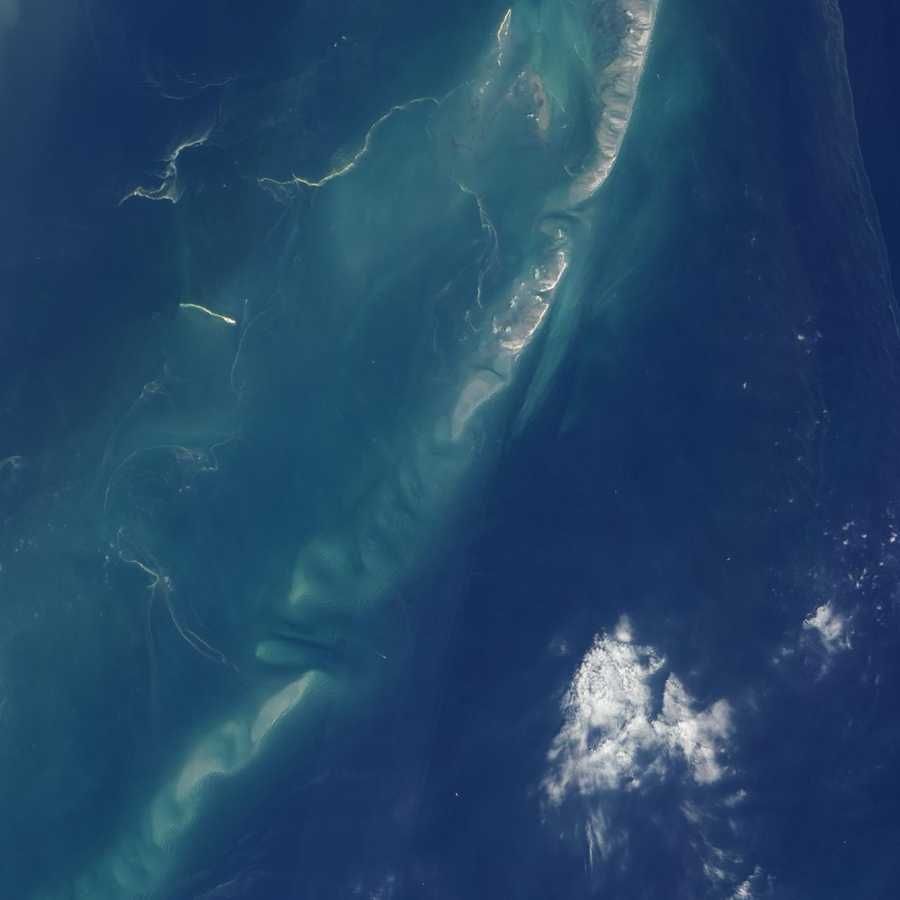 May 5: Light tan streamers snake across Chandeleur Sound in this detailed natural-color satellite image from May 5, 2010. The streamers are probably ropes of oil from a leaking well in the Gulf of Mexico.