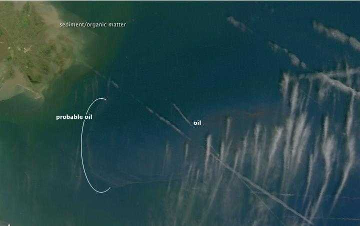 Close up: April 28. The eastern part of the oily area is covered by streaks of clouds, but the reddish streaks shown in photos of the slick appear to be visible. It appears that a tendril of oil is reaching out toward the tip of the delta.