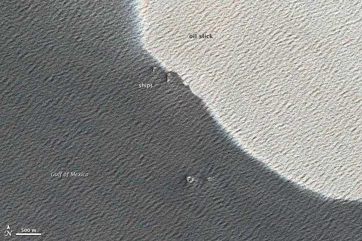 Close Up: April 25, the close-up view shows waves on the water surface, oil sheen as well as ships, presumably involved in the clean up and control activities.