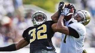 Robert Meachem battles Jabari Greer for the ball at Saints Training Camp in Metairie.