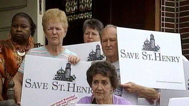 St. Henry Catholic Church parishioners protest the impending closure of their uptown church.