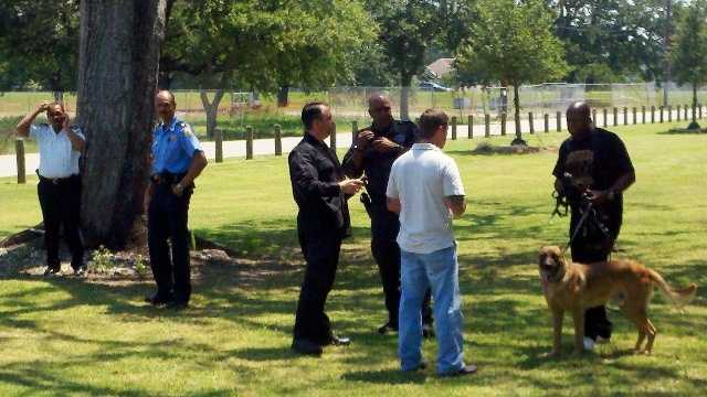 Law enforcement teams were searching City Park Thursday for a trustee who stripped off his jumpsuit and fled.
