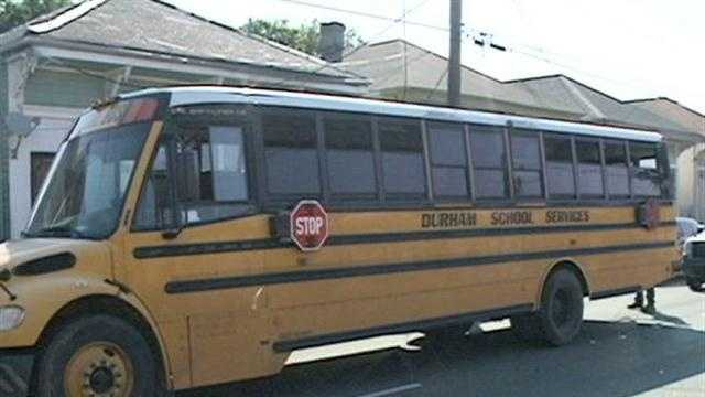 New Orleans police officers arrested a man who hit a school bus in Mid-City Monday morning and booked him with driving while intoxicated.
