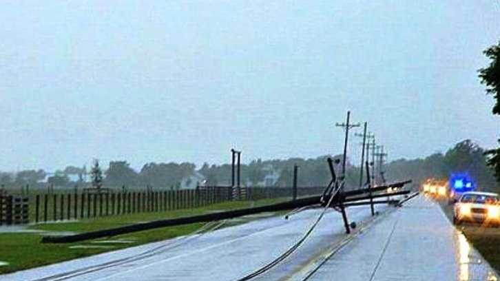Downed power poles block Hwy. 1 in Lafourche Parish.