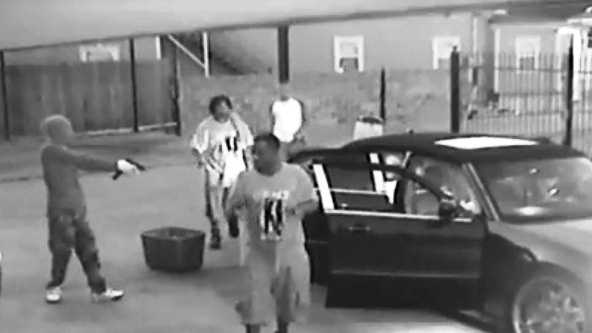 Images from a surveillance camera show armed men robbing workers at a Broadmoor car wash.
