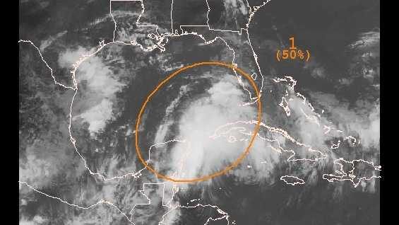 An area of low pressure near the Yucatan Peninsula has a 50 percent chance of developing into a tropical cyclone, the NHC said.