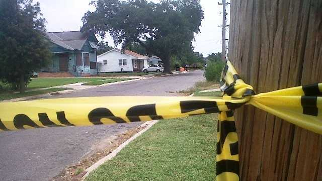 Crime tape marks off the area where a man was shot and killed on the afternoon of the Fourth of July.