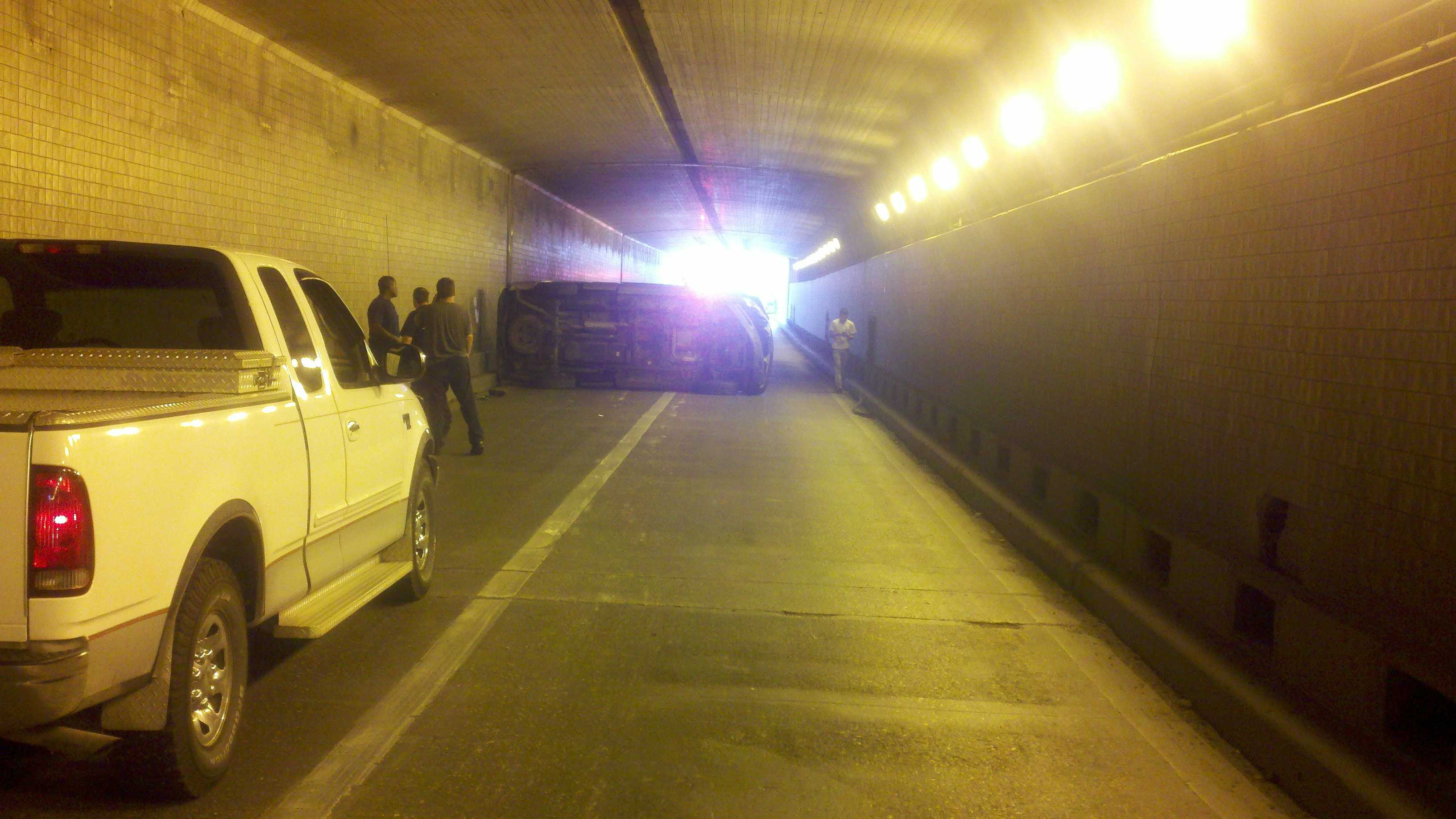 A vehicle overturns in the Belle Chasse Tunnel shutting down traffic moving southbound on Highway 23.