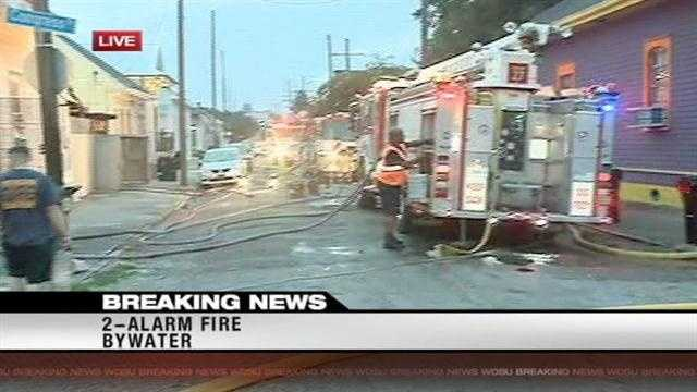 New Orleans firefighters battled a two-alarm fire in the Bywater Wednesday, which heavily damaged a home.
