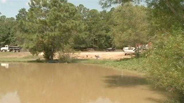Residents in a Slidell area subdivision are steaming because, they said, work crews started pumping silt into the pond behind their homes.