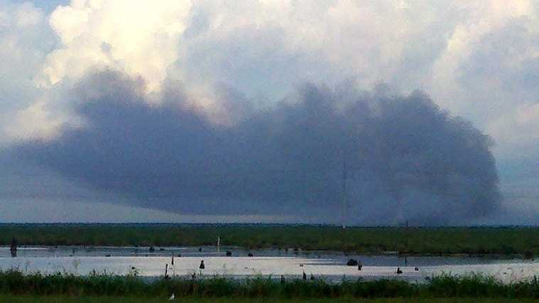 Smoke billows above St. Bernard Parish after lightning sparked a marsh fire.
