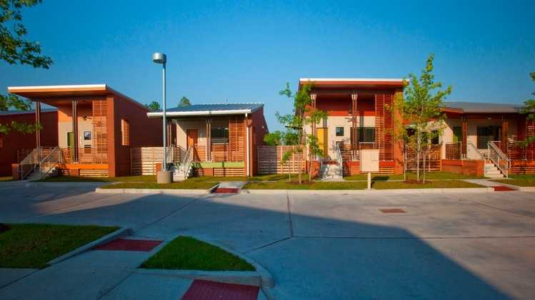 Holly and Smith Architects designed the 224-unit Village de Jardin complex.