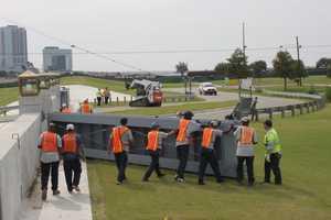 Crews close the Bonnabel flood gates Monday.