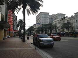 Shops on Canal Street board up in preparation for Isaac.