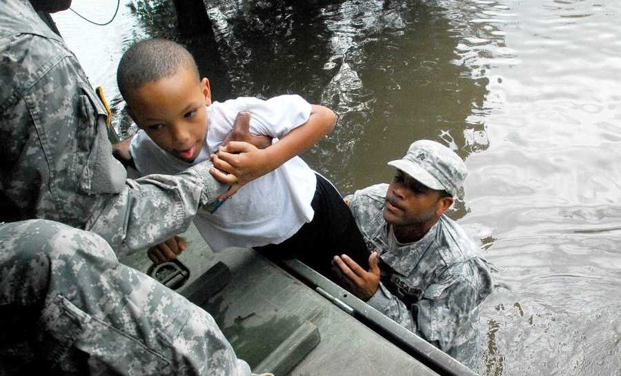 LAPLACE, La. - Sgt. Lee Savoy, a Soldier with the 256th Brigade Special Troops Battalion, evacuates a child, Aug. 30, 2012, from the flood waters caused by Hurricane Isaac.
