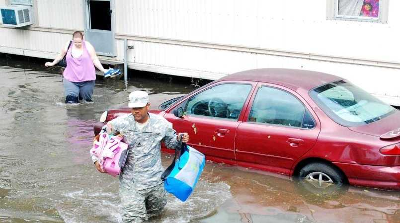 LAPLACE, La. - Sgt. Lee Savoy, a Soldier with the 256th Brigade Special Troops Battalion, helps evacuate trapped residents of St. John the Baptist Parish, Aug. 30, 2012.